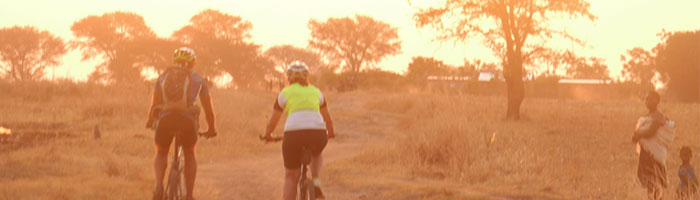 Two Cyclists in Zambia cycling off road