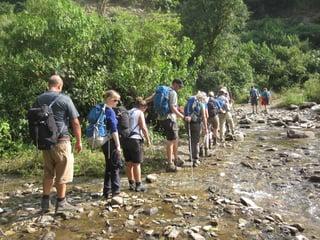 trekking along stream