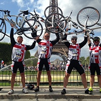 London_to_Paris_Eiffel_Tower_Cyclists.jpg