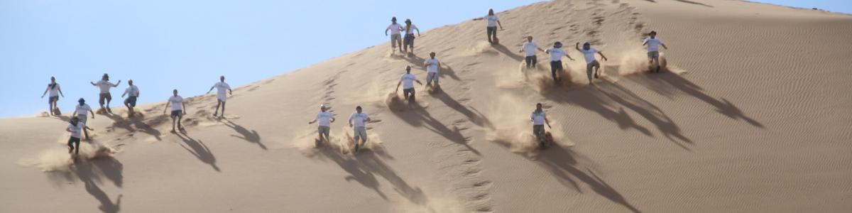 trekkers on sand dunes in morocco