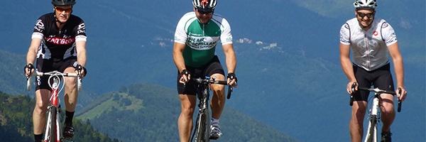 Three cyclists ride forward
