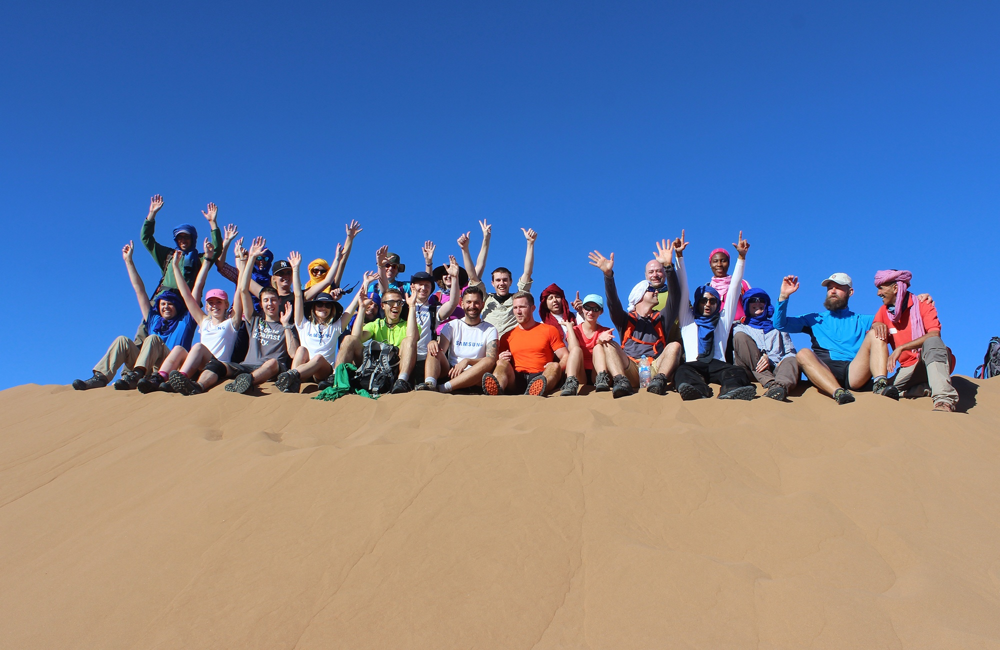 Discover_Adventure_challenge_group_celebrating_in_Sahara.jpg