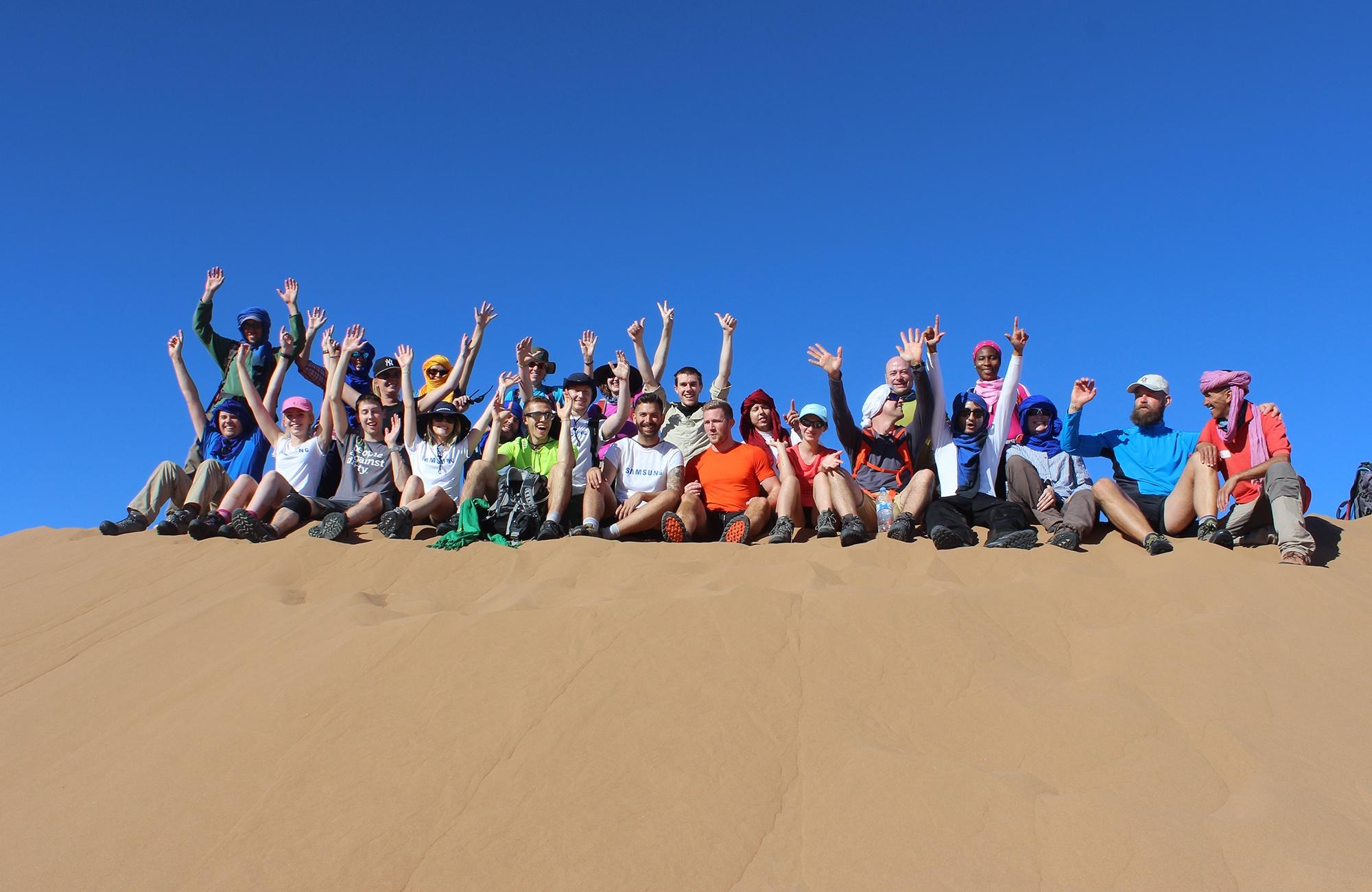 Discover_Adventure_challenge_group_celebrating_in_Sahara.jpg